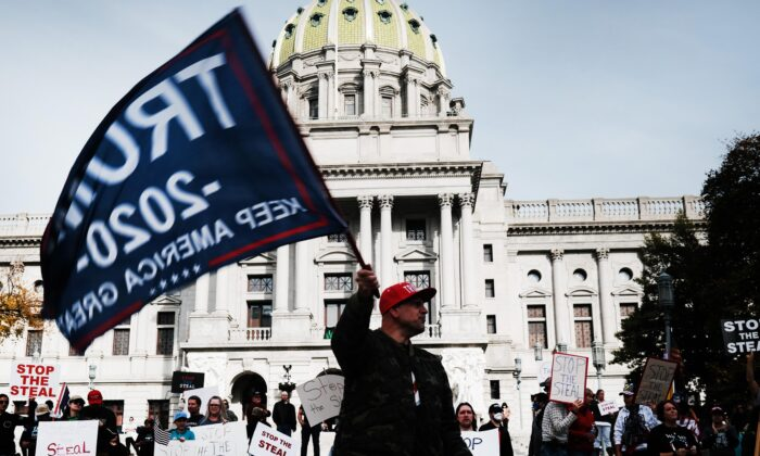 Dozens of people calling for stopping the vote count in Pennsylvania due to alleged fraud against President Donald Trump gather on the steps of the State Capital in Harrisburg, Penn., on Nov. 5, 2020. (Spencer Platt/Getty Images)