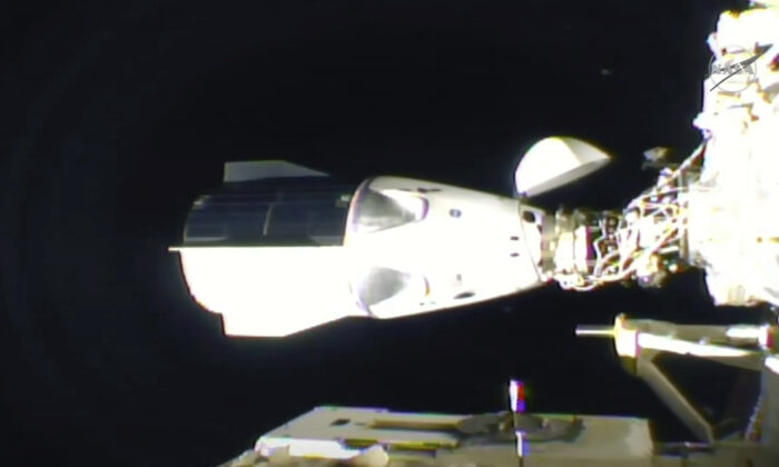 In this frame grab from NASA TV, the SpaceX Dragon is seen after docking at the International Space Station on Nov. 16, 2020. (NASA TV via AP)