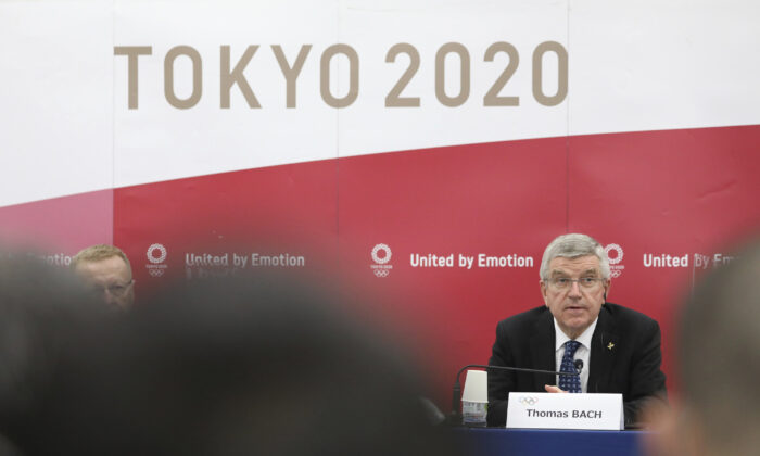 Thomas Bach, International Olympic Committee president, attends a press conference in Tokyo on Nov. 16, 2020. (Du Xiaoyi/Pool)