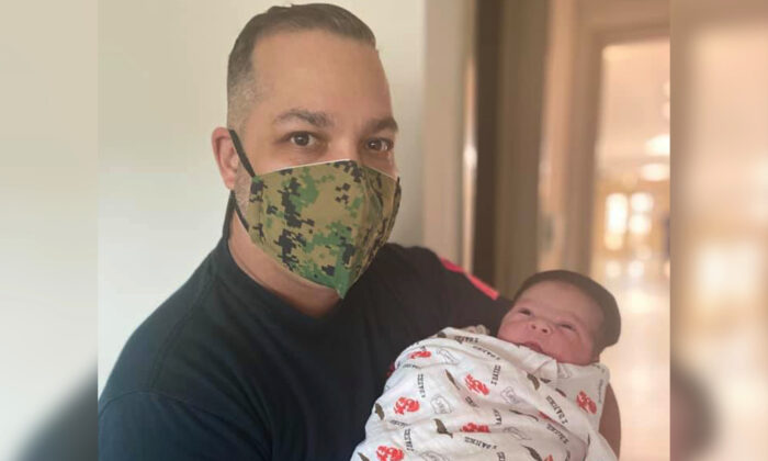Retired U.S. Marine Corps Staff Sgt. Orlando Ibanez with his baby son who was born on Nov. 10, 2020, the very same day as the Marines' 245th anniversary. (Courtesy of Mercy Hospital)