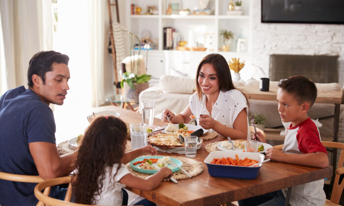 """W. Cleon Skousen, author of the 1958 book """"The Naked Communist."""" urges parents to """"make current events part of the dinner table talk."""" (Monkey Business Images)"""