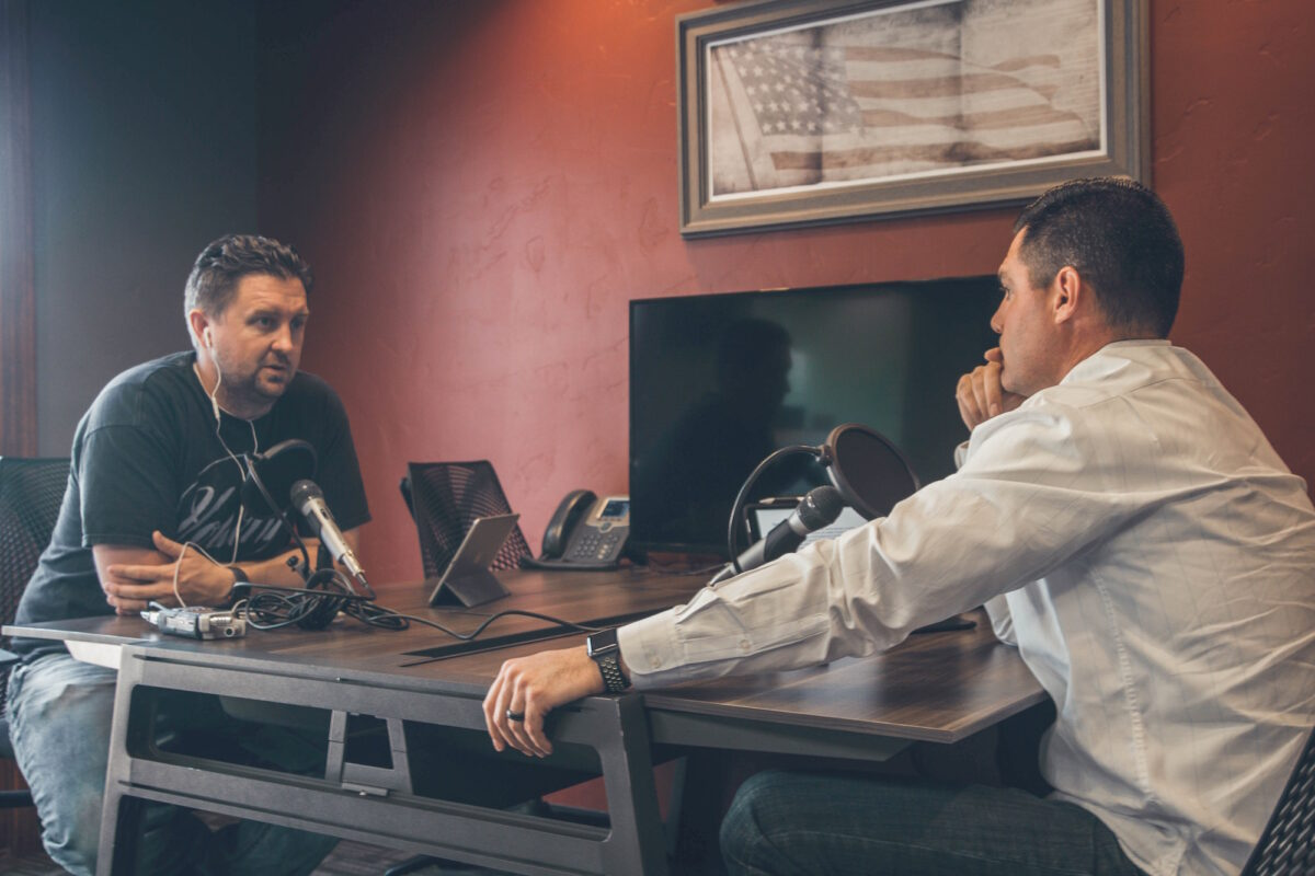 Two men talking.
