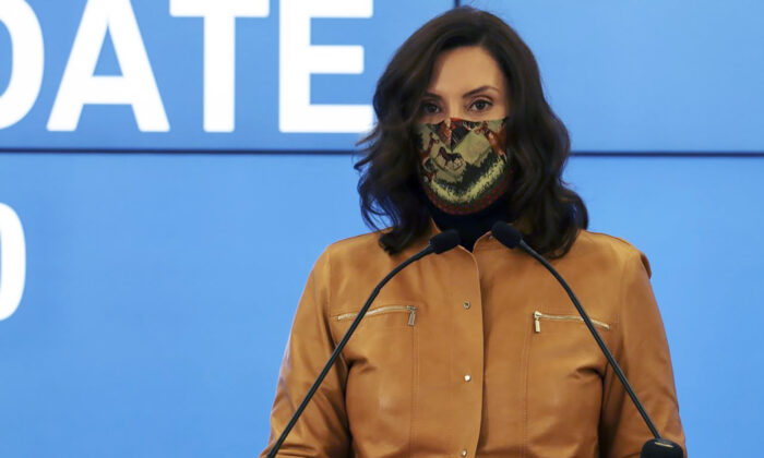 Michigan Gov. Gretchen Whitmer announces new restrictions amid the COVID-19 pandemic in Lansing, Mich., on Nov. 15, 2020. (Michigan Office of the Governor via AP)