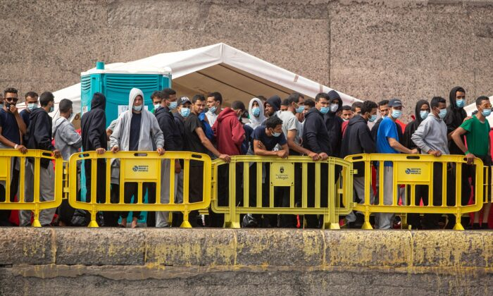 Migrants from a group of 1300 rescued from different boats remain in the port of Arguineguin while being cared for by the Spanish Red Cross and the National Police on the Spanish Canary island of Gran Canaria on Oct. 25, 2020. (Desiree Martin/AFP via Getty Images)