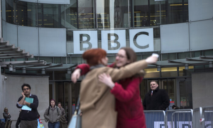 Two women embrace outside Broadcasting House, after MPs voted on a bill relating to the BBC licence fee, in London on March 25, 2014. (Oli Scarff/Getty Images)