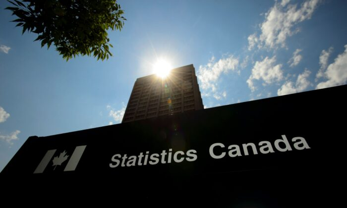 Statistics Canada building and signs are pictured in Ottawa on July 3, 2019. (The Canadian Press/Sean Kilpatrick)