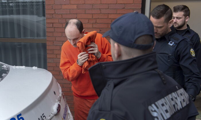 Matthew Vincent Raymond is taken from Court of Queen's Bench in Fredericton on March 13, 2020. (The Canadian Press/Andrew Vaughan)