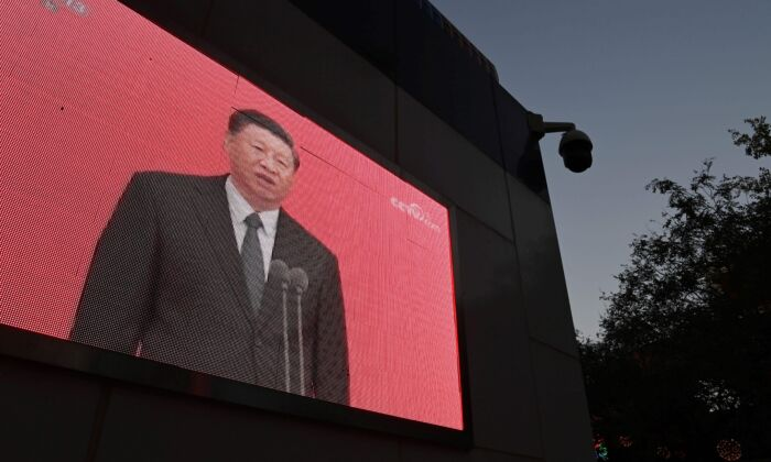 A video clip of Chinese leader Xi Jinping is seen on the outside of a police patrol station in Beijing on Nov. 2, 2020. (Greg Baker/AFP via Getty Images)
