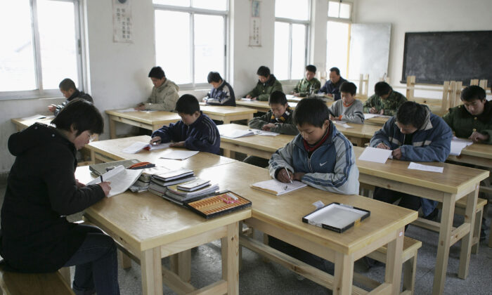 Students of the Xu Xiangyang Education and Training Workroom attend a writing class in Huaian city, Jiangsu Province, China, on March 12, 2005. (China Photos/Getty Images)