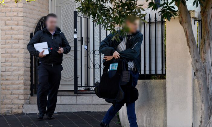 Federal agents are seen leaving the home of NSW Labor MP Shaoquett Moselmane in Rockdale, Sydney, Friday, June 26, 2020. (AAP Image/Bianca De Marchi)