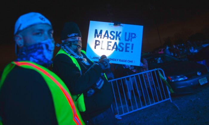 Workers display a sign during the Montage Mountain rave in Scranton, Pennsylvania, on Oct. 23, 2020. (Kena Betancur/AFP via Getty Images)