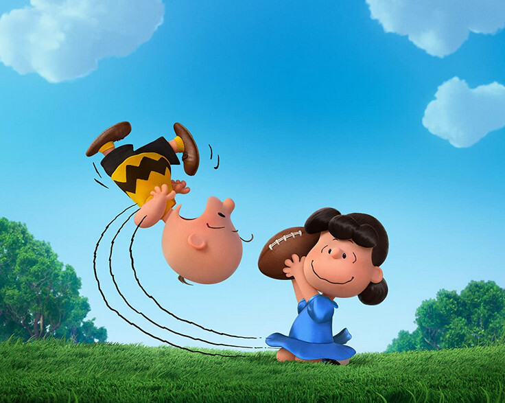 "boy flying up in the air, girl holding football in ""The Peanuts Movie"""