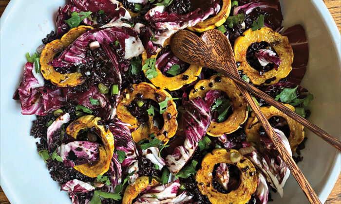 This vibrant salad is layered with toothsome nutty black rice, juicy-crisp radicchio leaves, and spice-roasted delicata squash rings. (Lynda Balslev for Tastefood)
