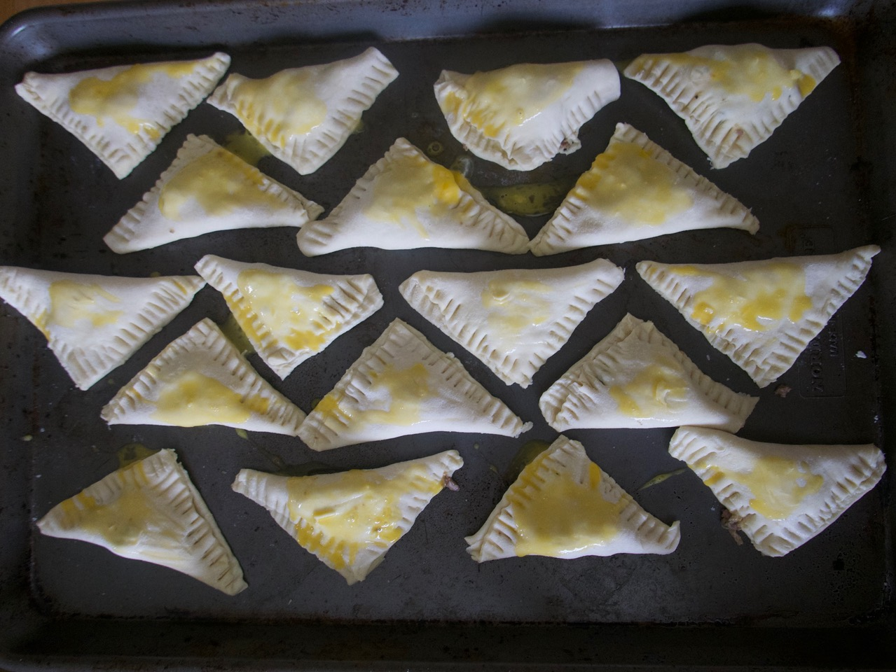 turnovers sealed and brushed with egg