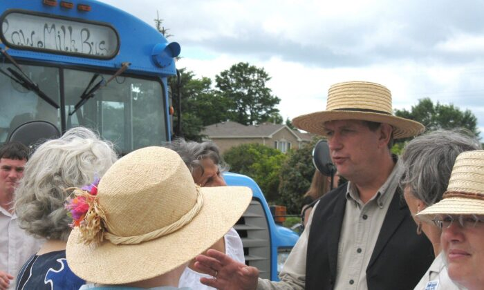 Dairy farmer and raw milk advocate Michael Schmidt talks to supporters outside court in Newmarket, Ont., on July 31, 2008. Schmidt has been fighting to make raw milk legal in Ontario for about two decades. (The Canadian Press/Colin Perkel)