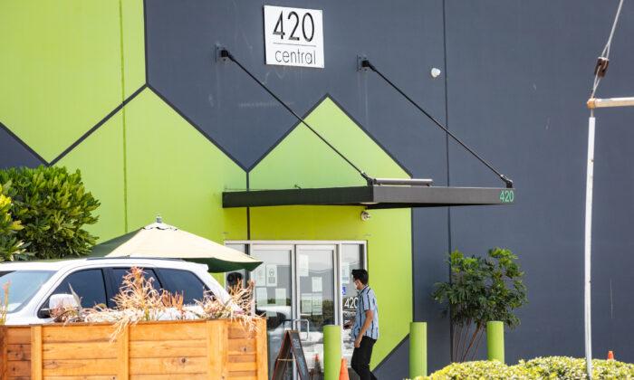 A man enters 420 Central cannabis shop in Santa Ana, Calif., on Aug. 14, 2020. (John Fredricks/The Epoch Times)