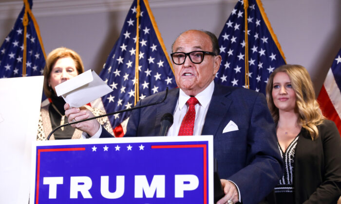 Trump lawyer and former New York City Mayor Rudy Giuliani speaks to media while flanked by lawyer Sidney Powell (L) and Trump campaign senior legal adviser Jenna Ellis at a press conference at the Republican National Committee headquarters in Washington, on Nov 19, 2020. (Charlotte Cuthbertson/The Epoch Times)