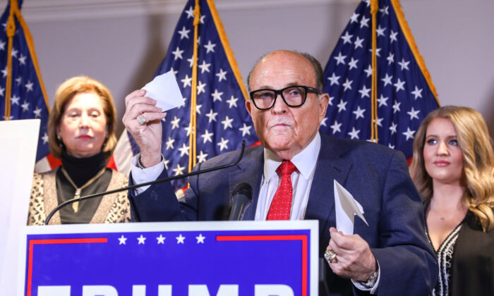 Trump lawyer and former New York City Mayor Rudy Giuliani speaks to media while flanked by Trump campaign lawyer Sidney Powell (L) and Trump campaign senior legal adviser Jenna Ellis at a press conference at the Republican National Committee headquarters in Washington on Nov. 19, 2020. (Charlotte Cuthbertson/The Epoch Times)