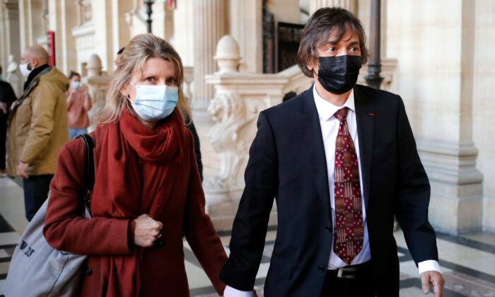 French-American Mark Moogalian, right, and his wife Isabelle arrive at the Thalys attack trial, at the Paris courthouse, on Nov. 19, 2020. The lawyer for an American who was scheduled to testify about his role in the dramatic capture of an ISIS terrorist operative aboard a high-speed train says his witness has been hospitalized after he flew in to Paris. (Francois Mori/AP Photo)
