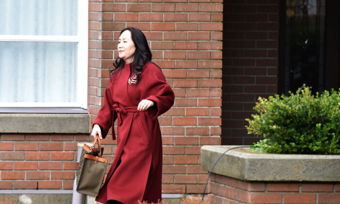Huawei Chief Financial Officer, Meng Wanzhou, leaves her Vancouver home to appear in British Columbia Supreme Court, in Vancouver, Canada on November 17, 2020. (Don Mackinnon/AFP via Getty Images)