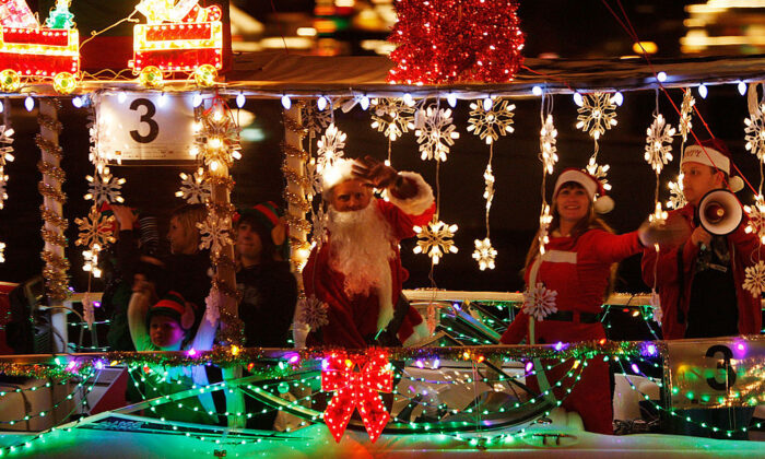 Boats in the 101st annual Newport Beach Christmas Boat Parade are lit with Christmas decorations as they move through the night in Newport Beach, Calif., on Dec. 16, 2009. (David McNew/Getty Images)