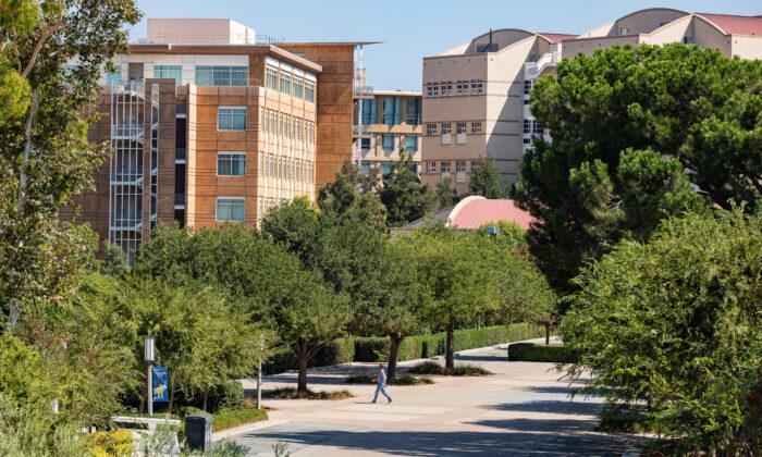 A student crosses the University of California–Irvine campus in Irvine, Calif., on Sept. 25, 2020. (John Fredricks/The Epoch Times)