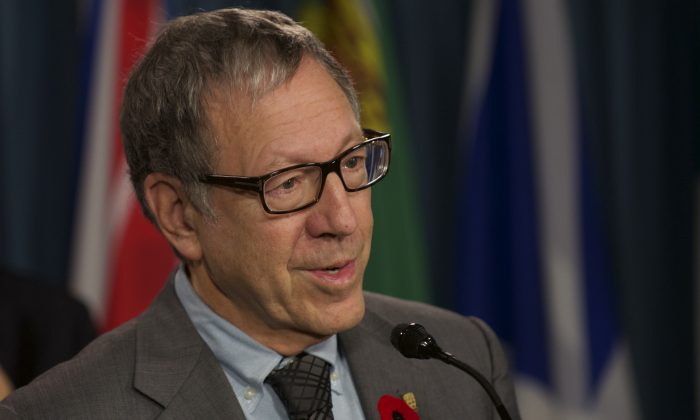Irwin Cotler, former minister of justice and former attorney general of Canada, speaks during a press conference on Parliament Hill in a file photo. Cotler has authored a new report for a coalition of independent international legal experts exploring ways to increase protection for journalists. (Matthew Little/The Epoch Times)