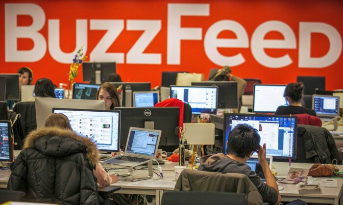 Buzzfeed employees work at the company's headquarters in New York on Jan. 9, 2014. (Brendan McDermid/Reuters)
