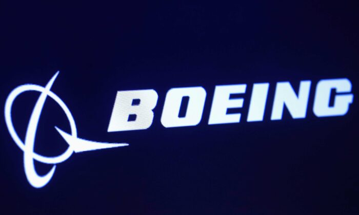The company logo for Boeing is displayed on a screen on the floor of the New York Stock Exchange (NYSE) in New York on March 11, 2019. (Brendan McDermid/Reuters)