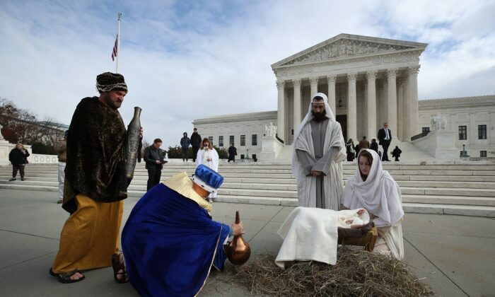 A couple portrays Mary and Joseph during a live nativity scene in front of the U.S. Supreme Court, on Capitol Hill in Washington on Dec. 4, 2019. (Mark Wilson/Getty Images)