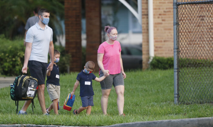Students return to school at Seminole Heights Elementary School in Tampa, Fla., on Aug. 31, 2020. (Octavio Jones/Getty Images)