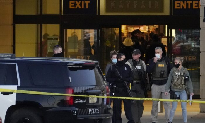 FBI officials and police stand outside the Mayfair Mall after a shooting, on Nov. 20, 2020, in Wauwatosa, Wis. (Nam Y. Huh/AP Photo)