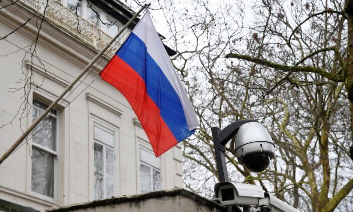 A flag flies outside the consular section of Russia's Embassy in London, on March 20, 2018. (Toby Melville/Reuters)