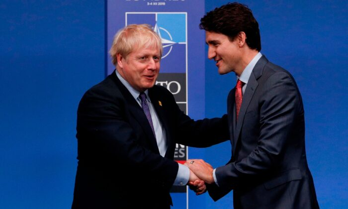 Britain's Prime Minister Boris Johnson (L) shakes hands with Canada's Prime Minister Justin Trudeau upon arrival for the NATO summit in Watford, northeast of London, on Dec. 4, 2019. (Adrian Dennis/AFP via Getty Images)
