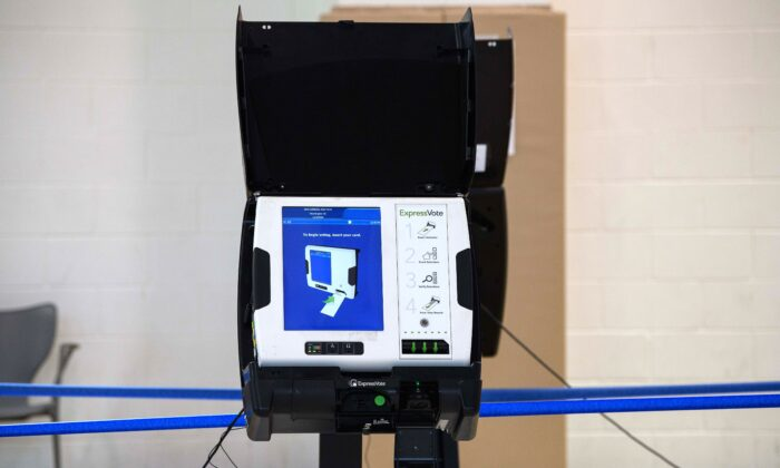 An electronic voting machine is seen at a polling station in Washington, on Oct. 29, 2020. (Nicholas Kamm/AFP via Getty Images)