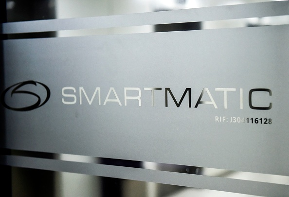 Picture of the logo of Smartmatic, the firm that supplies Venezuela's voting technology, seen on a sliding door at the headquarters of the company in Caracas, on Aug. 2, 2017. (Ronaldo Schemidt/AFP via Getty Images)
