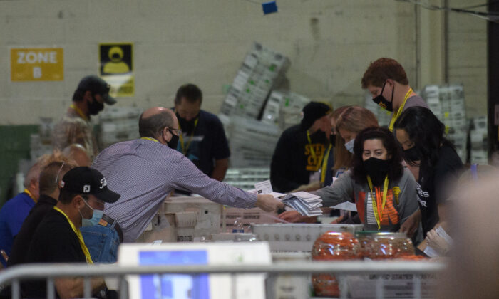 Allegheny County election employees organize ballots at the Allegheny County elections warehouse in Pittsburgh, Pa. on Nov. 7, 2020. (Jeff Swensen/Getty Images)