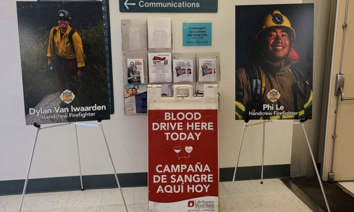 Pictures of two firefighters injured in the Silverado Fire flank a sign indicating a blood drive being held in their honor at the Orange County Global Medical Center in Santa Ana, Calif., on Nov. 19, 2020. (Courtesy of the Orange County Fire Authority)