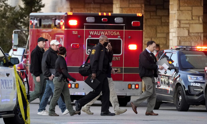 Police officials walk to the Mayfair Mall, in Wauwatosa, Wis., on Nov. 20, 2020. (AP Photo/Nam Y. Huh)