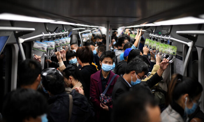 Passengers wearing masks ride the subway in Beijing on Oct. 23, 2020. (Noel Celis/AFP via Getty Images)