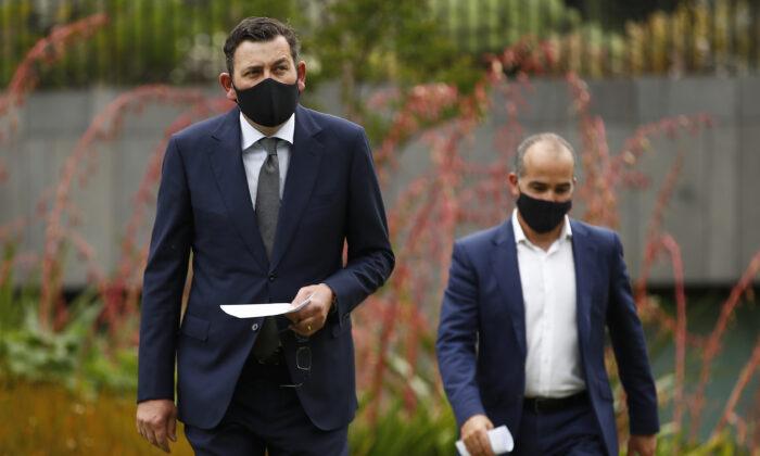 Victorian Premier Daniel Andrews (L) arrives with Deputy Premier James Merlino during a press conference in Melbourne, Australia on Nov. 12, 2020. (Daniel Pockett/Getty Images)