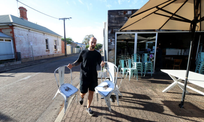 Mensur Delkic of Ballaboosta Cafe in Adelaide, Australia preparing to open after being in lockdown for 4 days on Nov. 22, 2020. (Kelly Barnes/Getty Images)