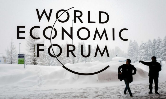 A security guard directs a man outside of the Davos Congress Centre ahead of the opening of the World Economic Forum (WEF) 2018 annual meeting, in Davos, Switzerland, on Jan. 22, 2018. (Fabrice Coffrini/AFP via Getty Images)