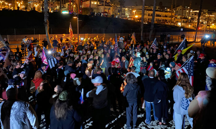 Citizens gather to protest the California curfew in San Clemente, Calif., on Nov. 21, 2020. (Jack Bradley/The Epoch Times)