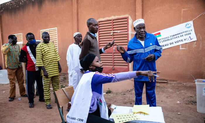 People line up to vote in Burkina Faso's presidential and legislative elections as polling stations open in Ouagadougou on Nov. 22, 2020. (Sophie Garcia/AP Photo)
