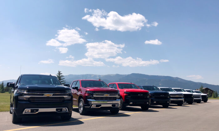 Eight versions of General Motors CO's new generation Chevrolet Silverado pickups are pictured lined up at an event near Alpine, Idaho, on Aug. 7, 2018. (Joseph White/Reuters)