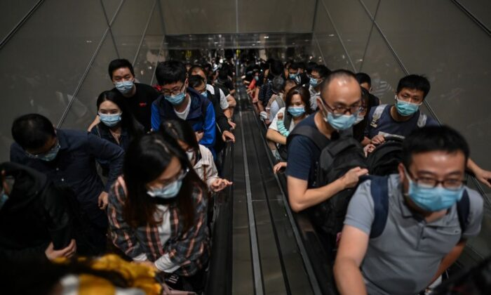 Passengers wearing masks arrive at Pudong International Airport in Shanghai on Sept. 29, 2020. (Hector Retama/AFP via Getty Images)