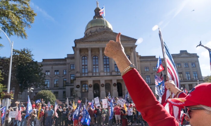 """Supporters of President Donald Trump host a """"Stop the Steal"""" protest outside of the Georgia State Capital building in Atlanta on Nov. 21, 2020. (Megan Varner/Getty Images)"""
