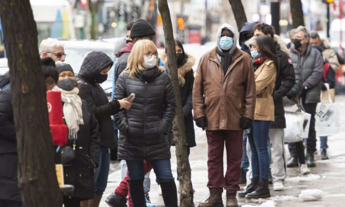 People line up outside a store in Montreal on Nov. 23, 2020, as various levels of COVID-19 restrictions continue across the country. (The Canadian Press/Ryan Remiorz)