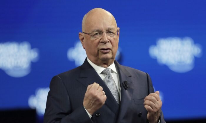 Klaus Schwab, founder and executive chairman of the World Economic Forum, delivers a welcome message on the eve of the annual meeting of the WEF in Davos, Switzerland, on Jan. 20, 2020. (AP Photo/Markus Schreiber)